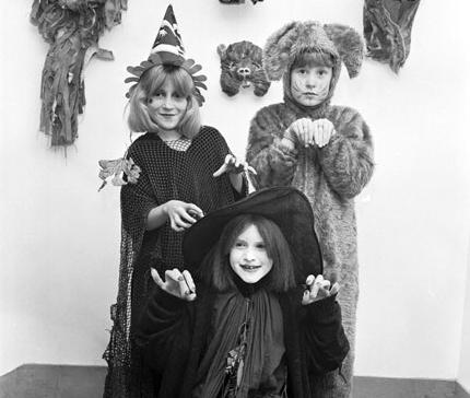 Three children in costume